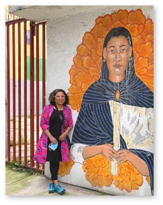 Claudia in Mexico with mural.